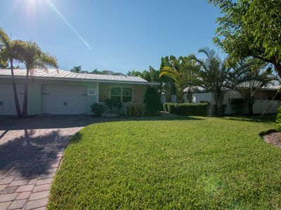 Two Bedroom Cottage with Tropical Landscaping Surrounding Private Heated Pool!