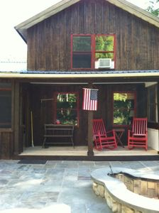Newly remodeled open air front porch to enjoy the fresh air and the firepit.