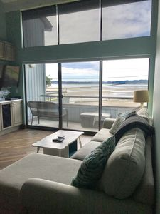 Photo for Luxurious bayview condo steps from the beach