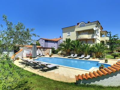 Photo for Apartment with large pool, air conditioning, WiFi and only 700 meters to the sandy beach