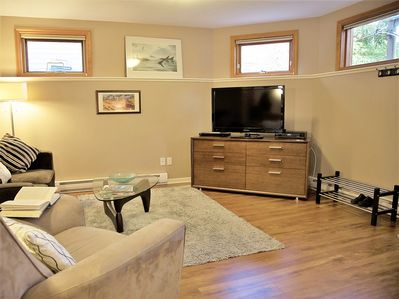 Living area with a large flat screen TV and DVD player