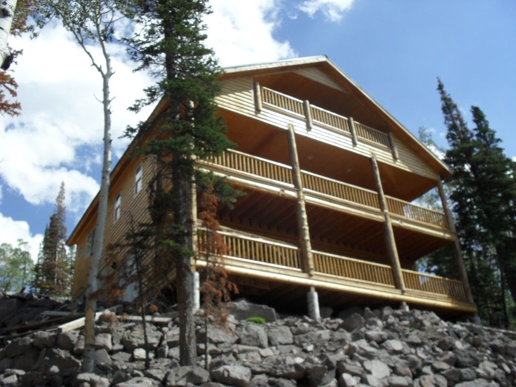 cabin pines rental rentals lodge by in brian surrounded trees cabins beautiful and whispering head vacation property