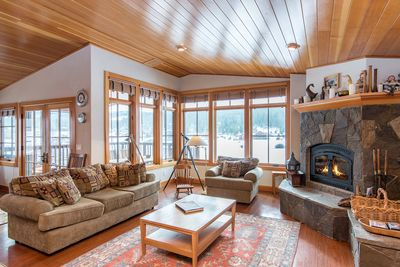 Living Room - Welcome to Truckee! Your rental is professionally managed by TurnKey Vacation Rentals. Enjoy serene pond views from the rustic-chic living room.