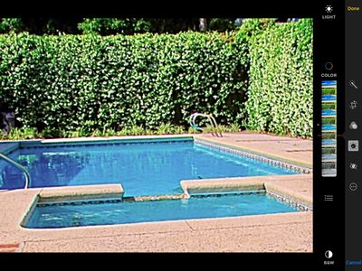 Larger pool for swimming laps or playing games can  be heated in off season