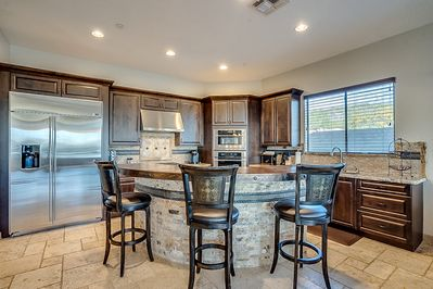 Fully stocked Gourmet Kitchen with GE Monogram stainless steel appliances