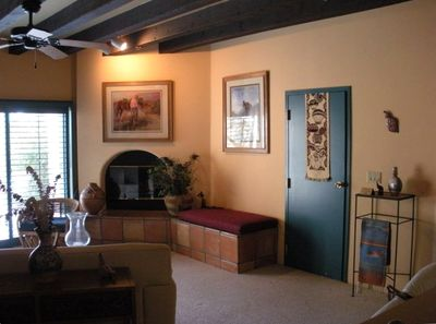 Spacious, furnished living area w/fireplace, tv, serene desert views.