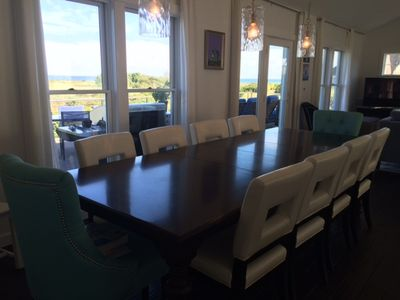 The open concept living/dining/kitchen area has expansive views of the Atlantic