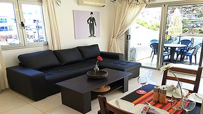 Photo for Modern clean apartment with access to swimming pool. 50m to the beach