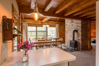 Dining room, with view out to lake Pauline. (Note: wood stove not for use)
