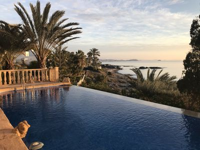 Photo for Beautiful beach front villa only metres from the water's edge
