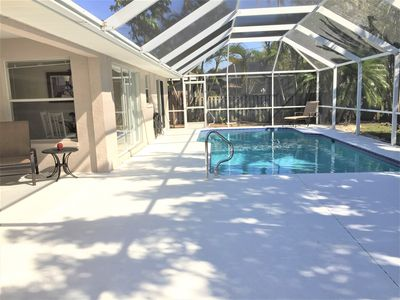Photo for Private fenced-in yard, HUGE lanai w/pool in beautiful Cape Coral Rose Garden