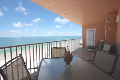 Enjoy a Cocktail or Dine Al Fresco while watching the Gorgeous Sunset on this Lovely Patio with Gulf Front Views