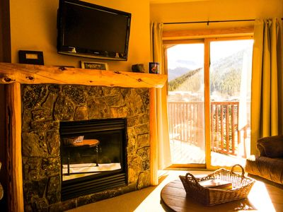 Cozy gas fireplace and large flat screen TV to relax by.