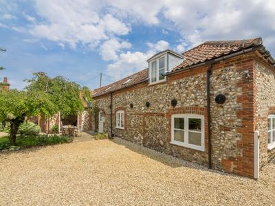 Photo for A charming converted stable at the edge the popular village of South Creake.
