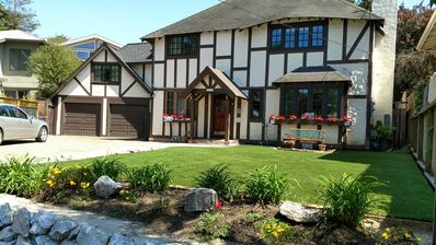 This Friends and Family Reunion home has a large croquet lawn in front yard.