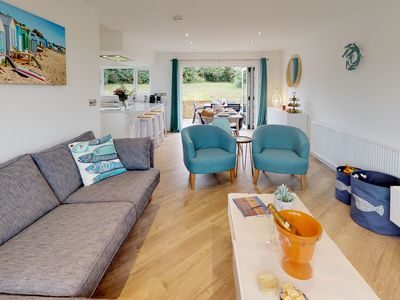 Photo for Stylish throughout, this detached bungalow in an elevated position on the Cae Du estate in Abersoch
