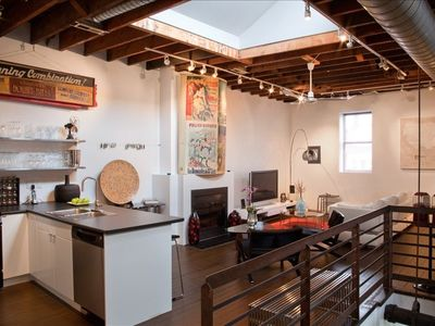 Photo for Spectacular Loft designed with the latest of contemporary furnishings and art.