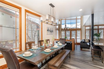 Enjoy this beautiful, open concept living space with a formal dining table that seats 8