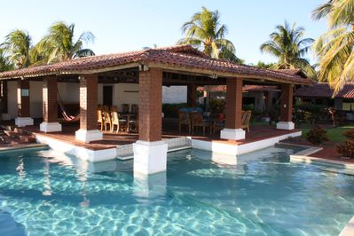 Pool with swim up bar, and covered lanai