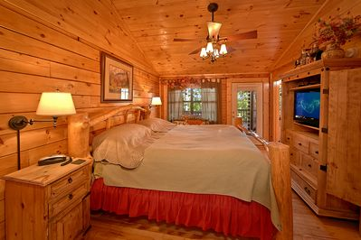 King Size Bedroom - This Pigeon Forge luxury cabin rental has everything your family or group of friends could ever ask for in a Smoky Mountain Resort Cabin. If you will be visiting Dollywood on your trip, this cabin has easy access to the #1 attraction in Tennessee.