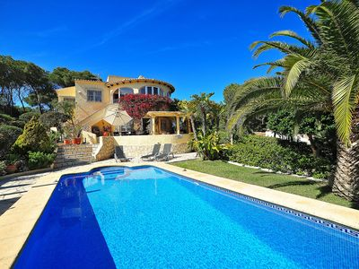 Photo for This 4-bedroom villa for up to 9 guests is located in Javea and has a private swimming pool, air-con