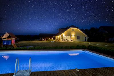 night view of the house from the swimming pool