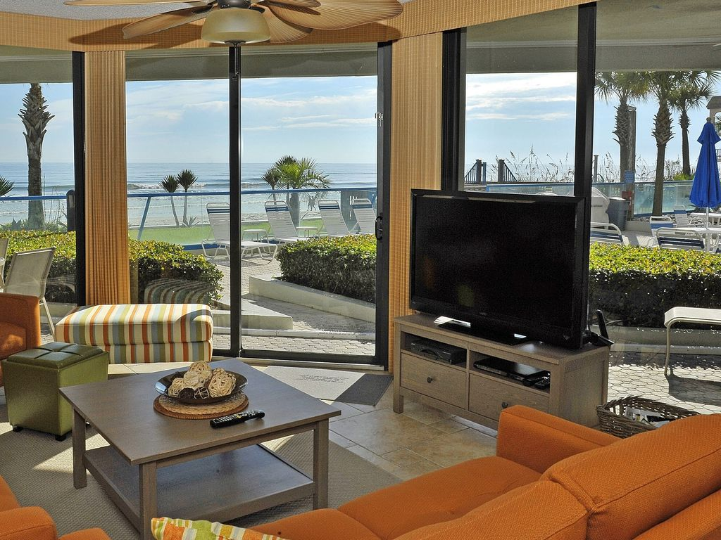 Newly renovated direct oceanfront condo wit vrbo relax with your favorite movie after a day at the beach nvjuhfo Gallery