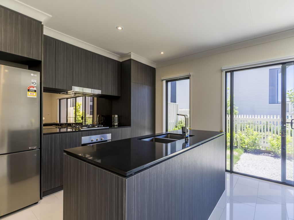 Escape to brand new, modern home in Hope Island