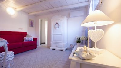 Photo for Elegant apartment in the heart of the historic center a step away from the sea.