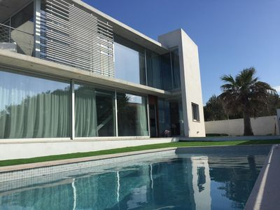 Photo for Modern glass villa with pool and sea views. Near the beach