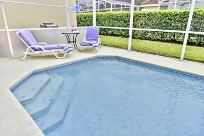 Very private pool with sun loungers and occasional table