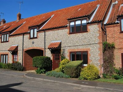 Photo for A modern flint faced mid terraced house in the centre of the attractive village of Ringstead.
