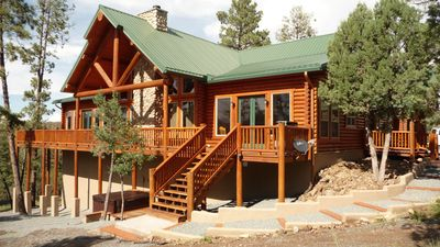 Beautiful side view of the Chalet style log home.
