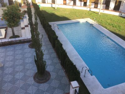 Photo for Apartment with hared pools & private roof terrace with quite beach 10m drive