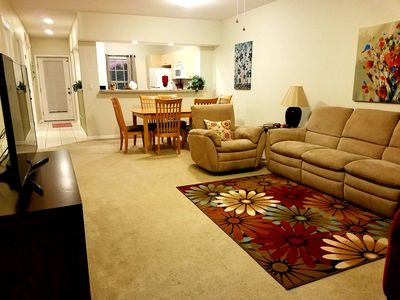 large living room, smart TV, reclining couch