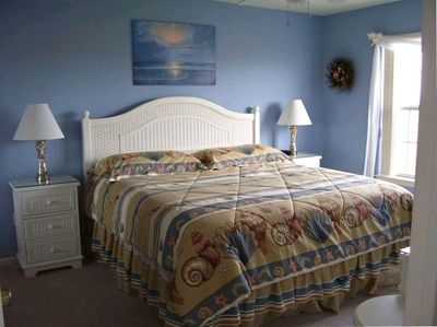 roomy king size bed in master bedroom