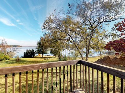 Photo for NEW LISTING! Charming lakefront cabin on two acres with dock &  firepit