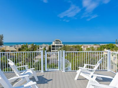 Photo for Gulf Access with Dock. Resort Style Pool with ROCK WATER SLIDE. SLEEPS 22 in Beds. Gulf Views. Roof Top Deck. Walk to Beach and Downtown Village. Property Manager Program.