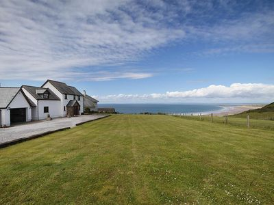 Photo for Overlooking the sea, Glebe Farm is a fabulous holiday home oozing style with luxurious touches. From