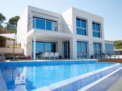 Photo for Modern villa with stunning sea views at walking distance to the beach