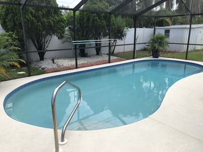 Photo for Beach style remodeled 2BR/2BA, screened pool, 9 minutes to beach