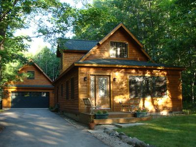 Charming quality built home with private Mullett Lake shared access.