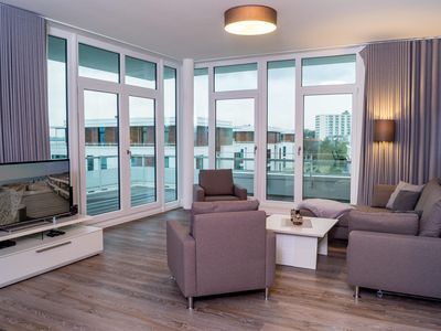 Photo for This 93 m² penthouse apartment offers a view of the Baltic Sea and is modern u