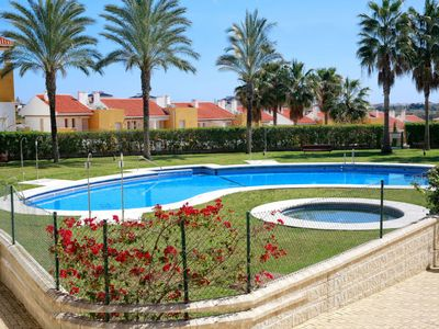 Photo for 2 bedroom Apartment, sleeps 4 with Pool, Air Con and Walk to Beach & Shops