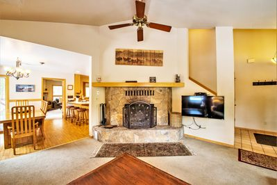 A flat screen TV and fireplace create a warm and entertaining area.