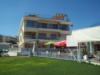 Photo for Excellent apartment located seconds from the sea with large enclosed patio