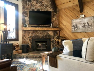 Wood burning rock fireplace to complete the mountain home experience