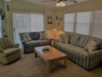 Family room with comfy new sofa and love seat
