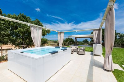 The terrace is complemented by a huge,  5 seater  Jacuzzi!