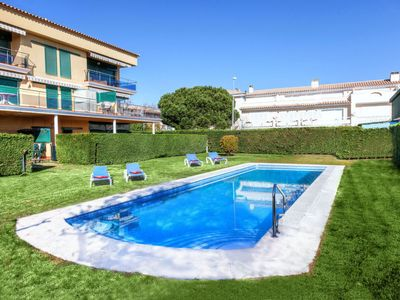 Photo for 3 bedroom Apartment, sleeps 6 with Pool, FREE WiFi and Walk to Beach & Shops